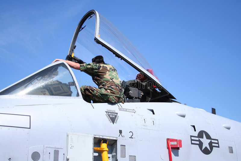 Combatiente y equipo de jet imagen de archivo libre de regalías