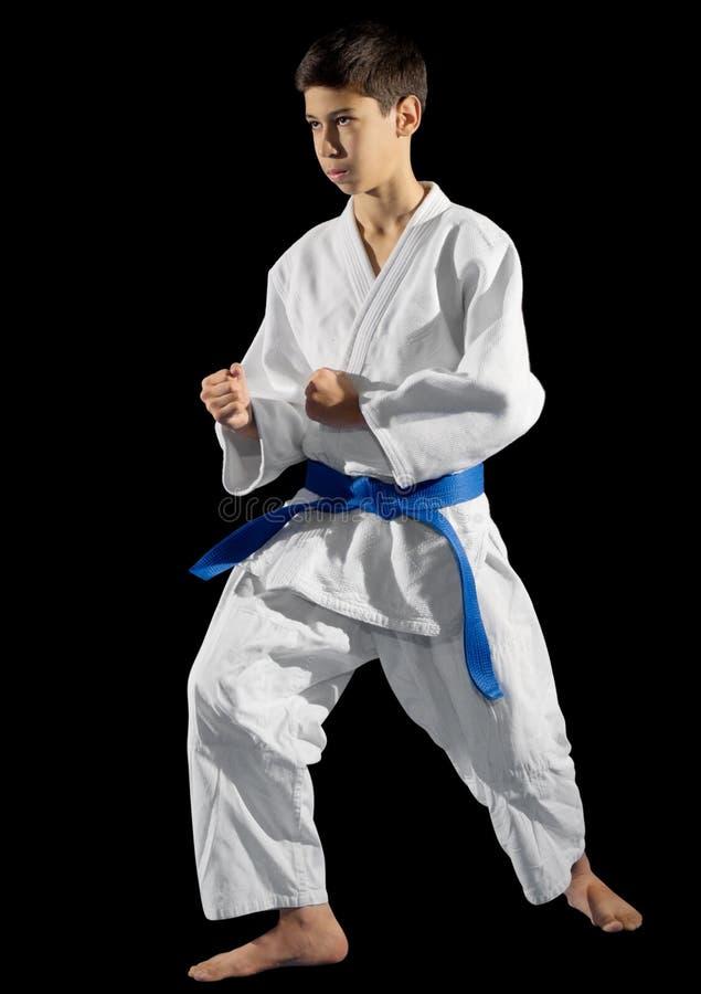 Combattant d'arts martiaux de garçon photo stock