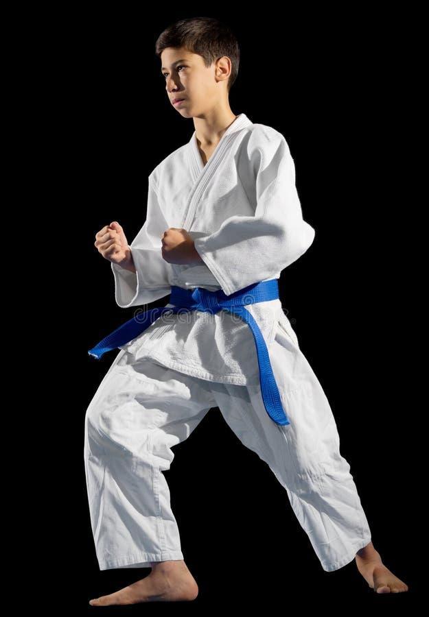 Combattant d'arts martiaux de garçon d'isolement photographie stock libre de droits