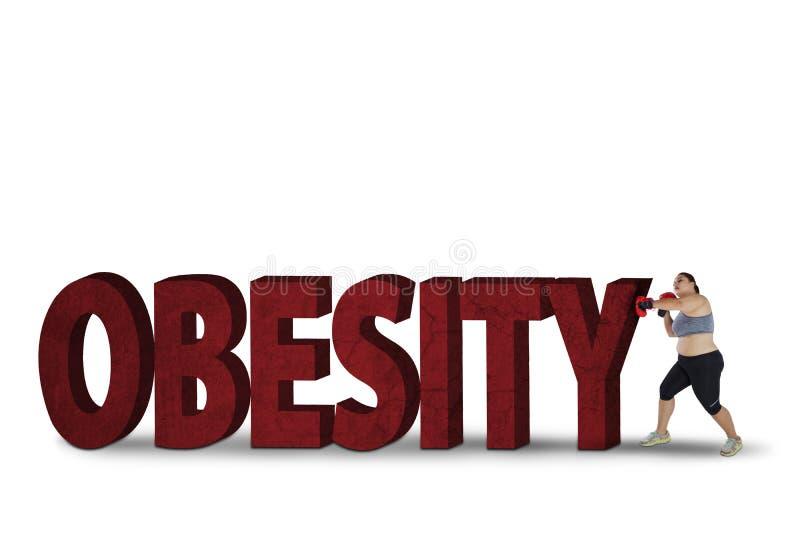 Combattimento grasso della donna con la parola di obesità immagini stock libere da diritti