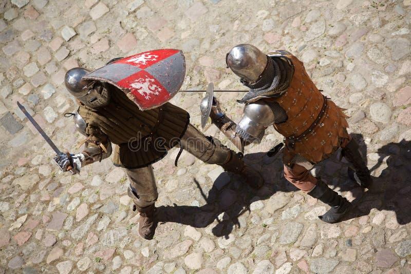 Combattimento medioevale dei cavalieri fotografia stock libera da diritti