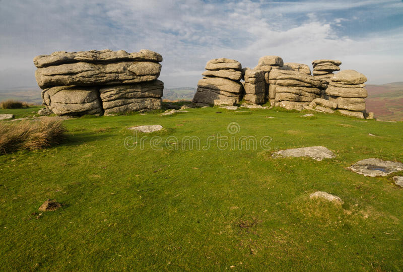 Combestone Tor, Dartmoor. Granite weathered stone outcrops of Combestone Tor. Dartmoor National Park, Devon, England, United Kingdom stock photos