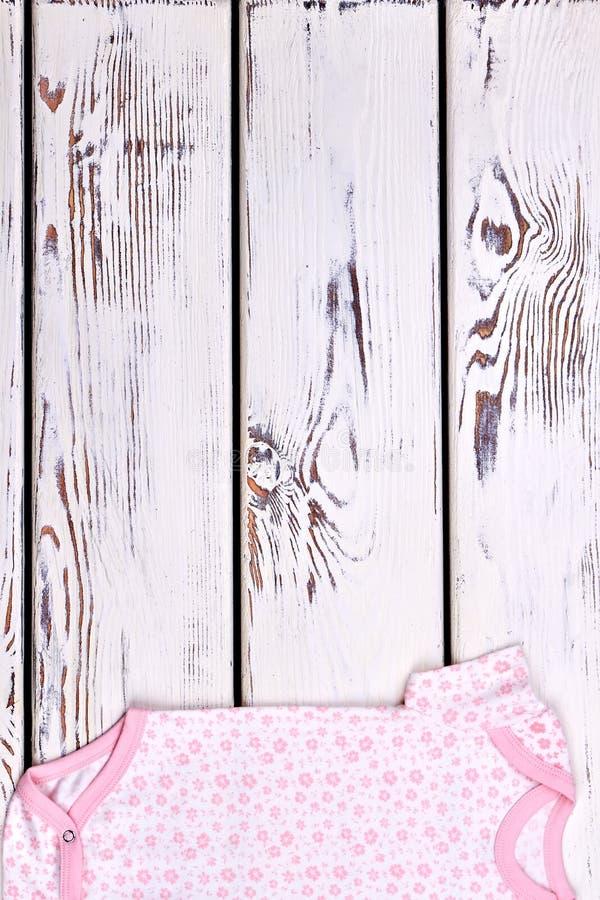 Combinaison de coton de bébé, image verticale photo stock