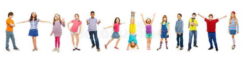 Combinaison des garçons et des filles d'isolement sur le blanc photo stock