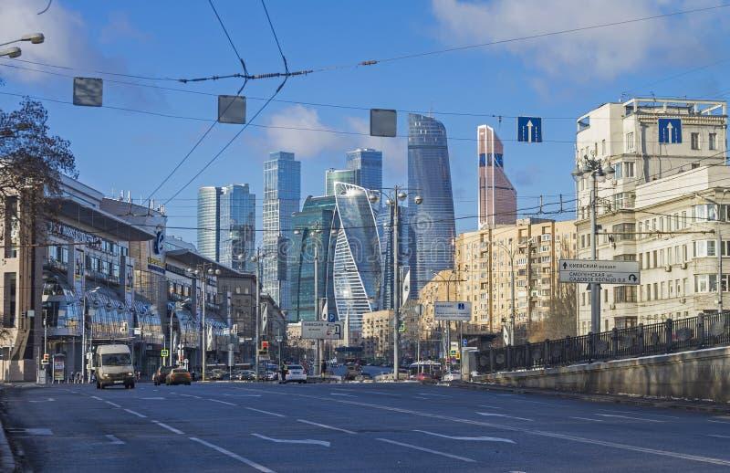 Combination of different architectural styles in Moscow. MOSCOW, RUSSIA - JANUARY 21, 2017: View from Borodinsky bridge along the Bolshaya Dorogomilovskaya royalty free stock photo