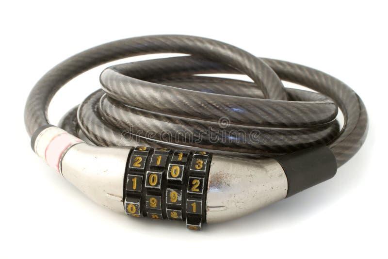 Combination lock. A sturdy combination bike lock made of steel stock photo