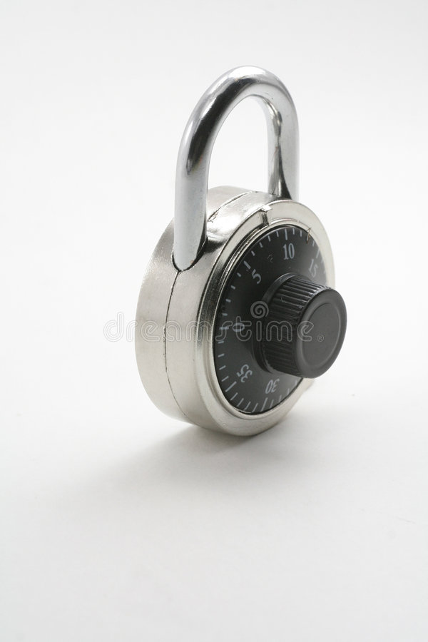 A combination lock. With a gray background royalty free stock images