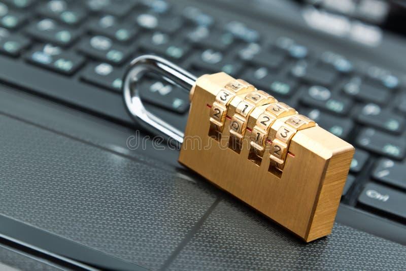 Combination lock. On laptop keyboard royalty free stock photo