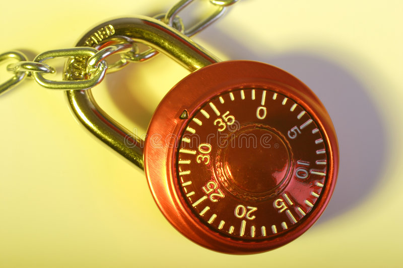 Combination lock. Red combination lock and chain royalty free stock photos