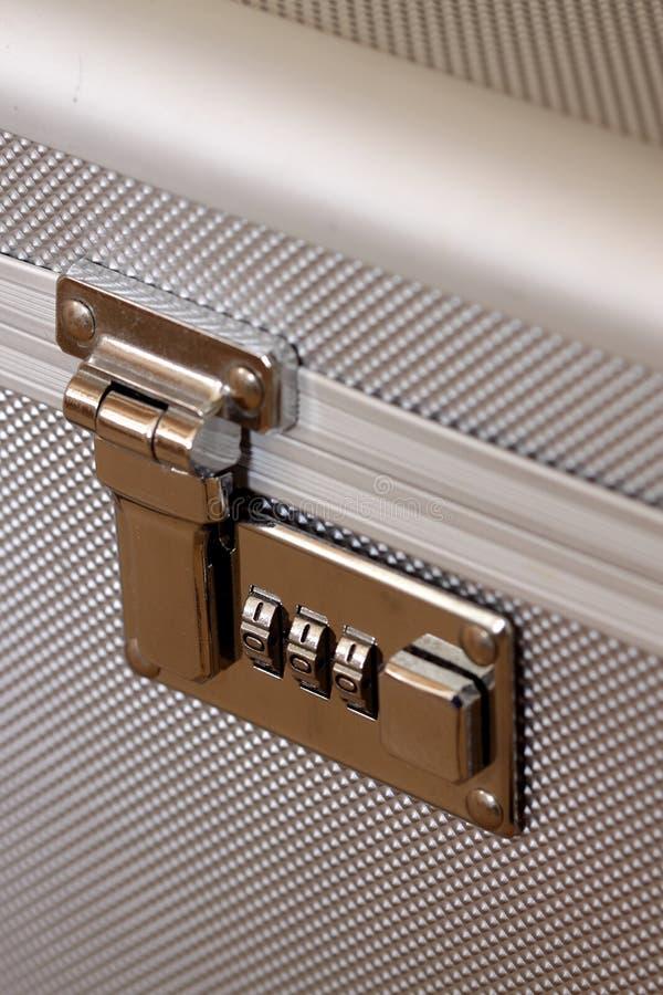 Combination lock. Photograph of a combination lock on an aluminium case royalty free stock photo