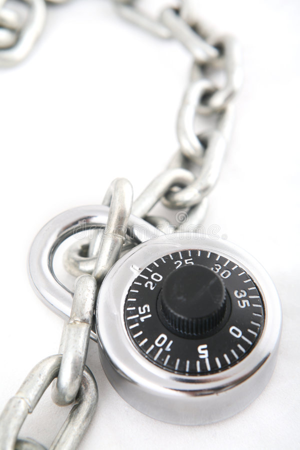 Combination Lock. A combination lock an a silver chain shot with shallow DOF royalty free stock image