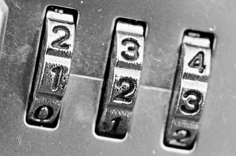 Combination Lock dials. Macro of combination lock - dials set to 123, Selective focus on first dial stock photography