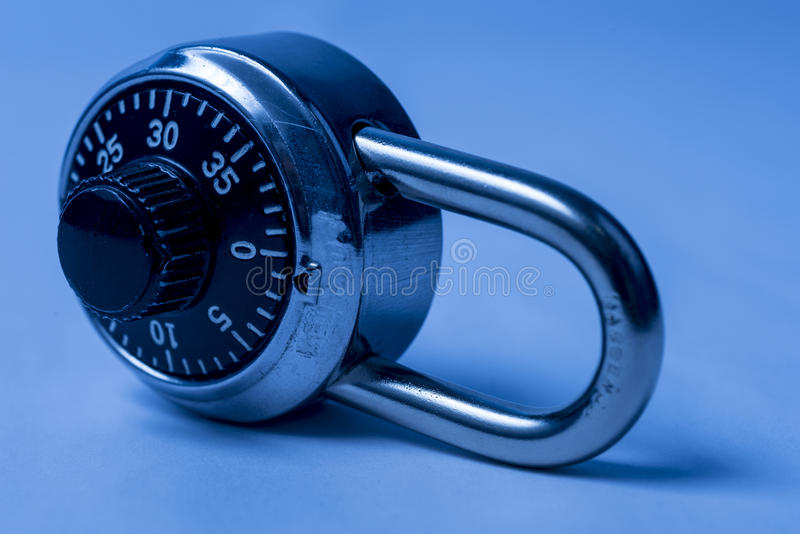 Combination lock. On its side with bluish tint stock photo