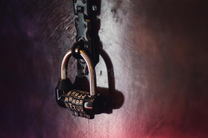 Combination lock in a Quest Escape Room. Vintage Combination lock in a Quest Escape Room to be opened and solved royalty free stock photo