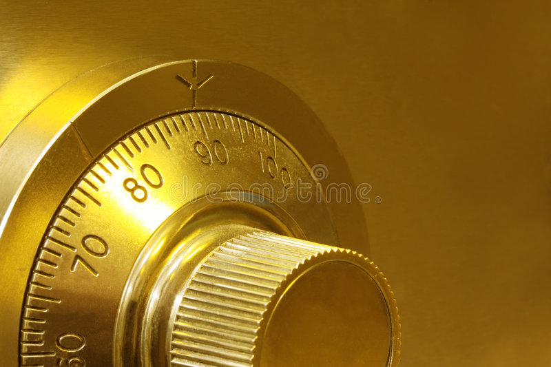 Combination Safe Lock. Golden toned combination safe lock, in close-up stock images