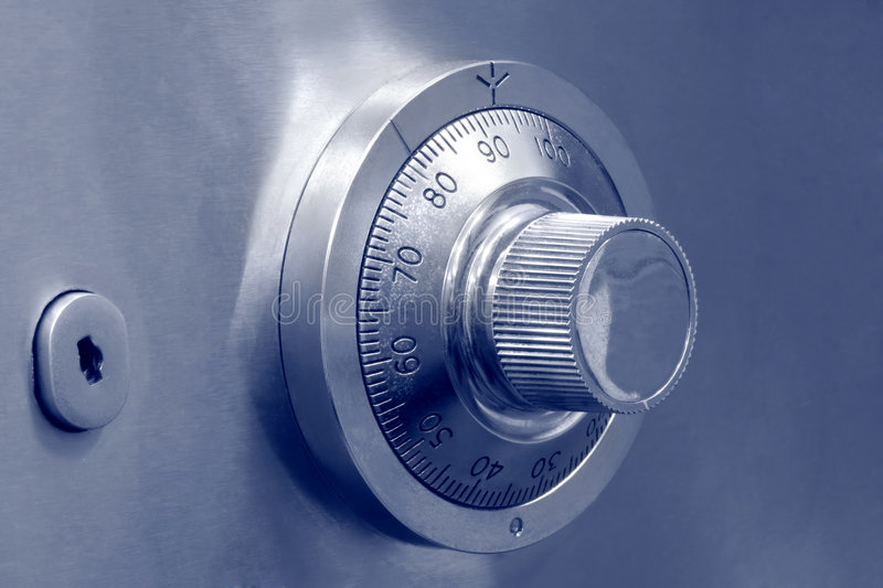 Combination safe lock and key. Combination dial safe lock and key lock royalty free stock photo