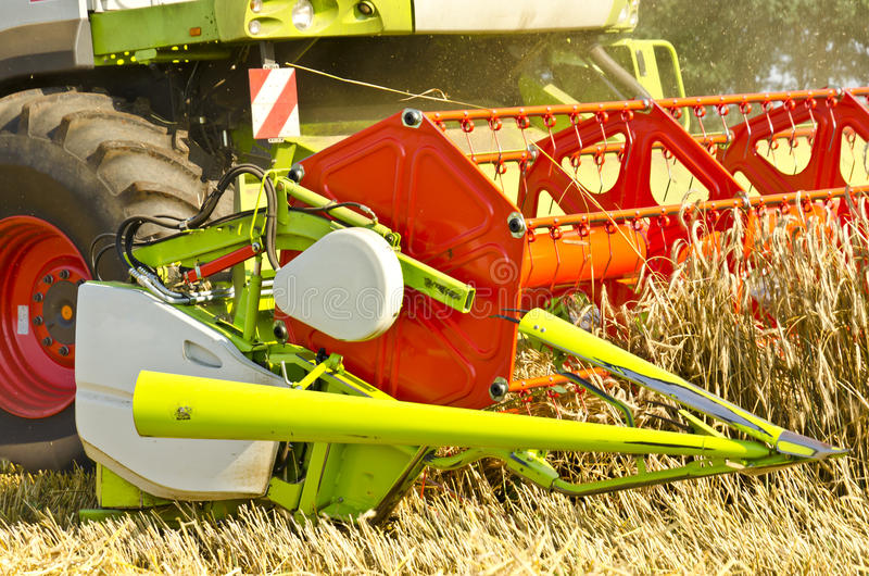 Combine harvester. Big one pursued on the surrounding field stock photo