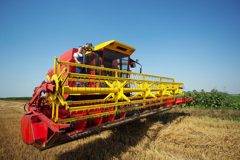 Combine harvester working on a wheat field royalty free stock image