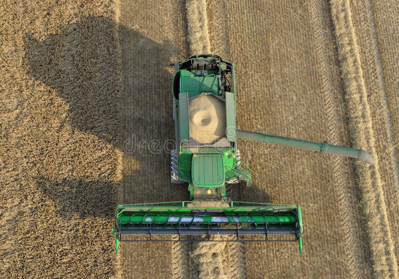 Combine laden with wheat. Waiting for a tractor to come to unload. Taken using a helium balloon platform stock images