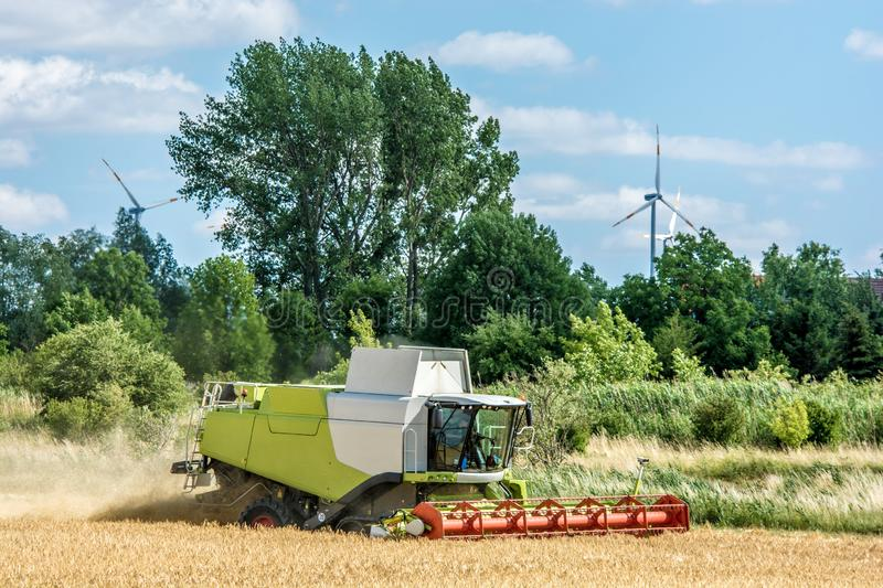 Combine with wind wheels stock photography