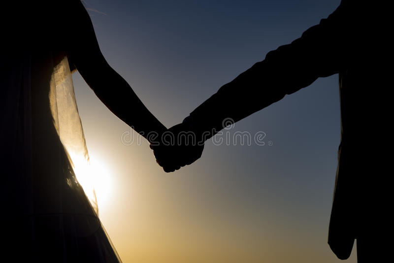 Combined with the hands of love. Wedding;Sunrise adventure for the Bride and groom.combined with the hands of love royalty free stock photos