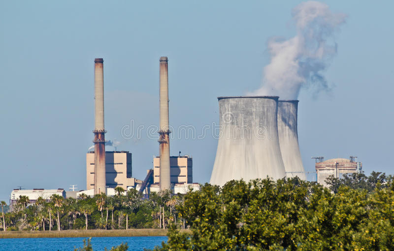 Combined Oil Fired and Nuclear Plants. Dual oil fired and nuclear power plants with nuclear containment structure stock images