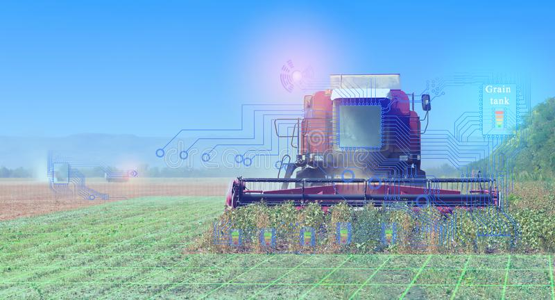 Combines harvest, conceptual representation of the interaction of technology when harvesting with the help of communication and th royalty free stock image