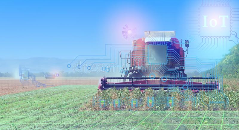 Combines harvest, conceptual representation of the interaction of technology when harvesting with the help of communication and th stock photography