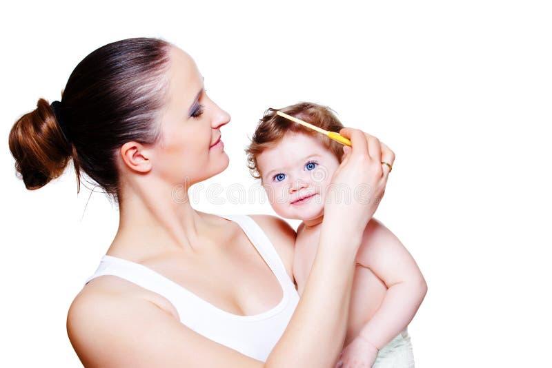 Combing baby hair stock photos