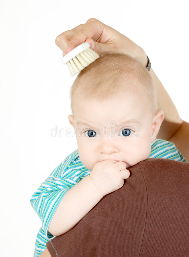 Combing baby`s hair royalty free stock photos