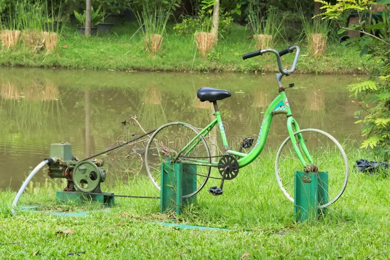 An interesting, inventive use of a bicycle frame, and human energy, as a water pump power source. Combining exercise and work, is this interesting, inventive royalty free stock photos