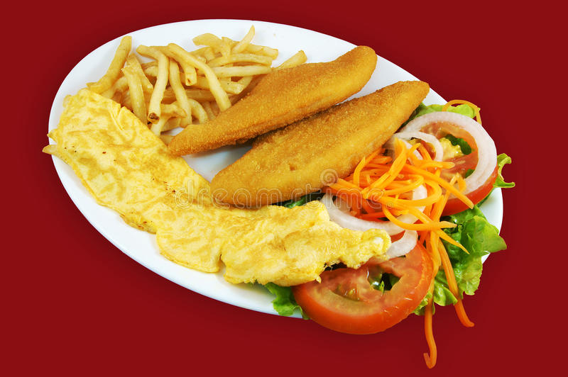 Combo plate bread fish. Combo plate of bread fish, omelette, french fries and salad stock photo