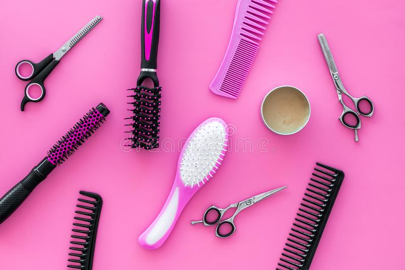 Combs for hairdresser hairdresser on pink background top view royalty free stock photos