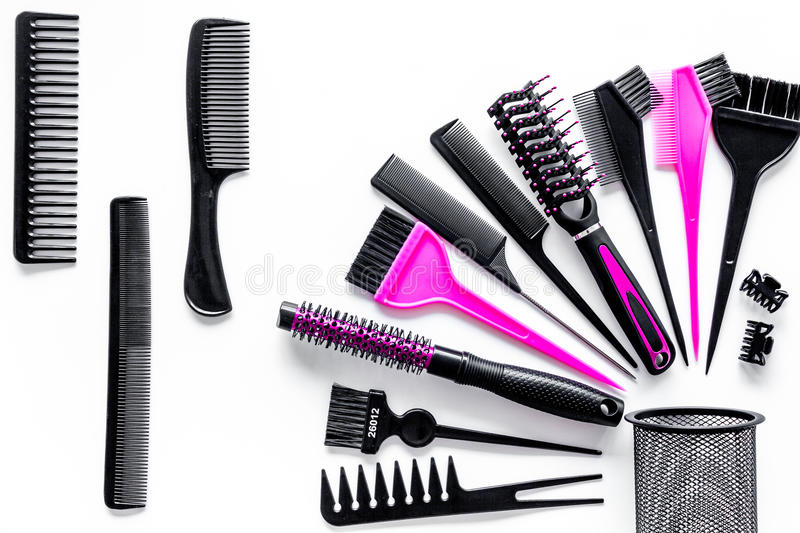 Combs and hairdresser tools in beauty salon on white background top view stock photography