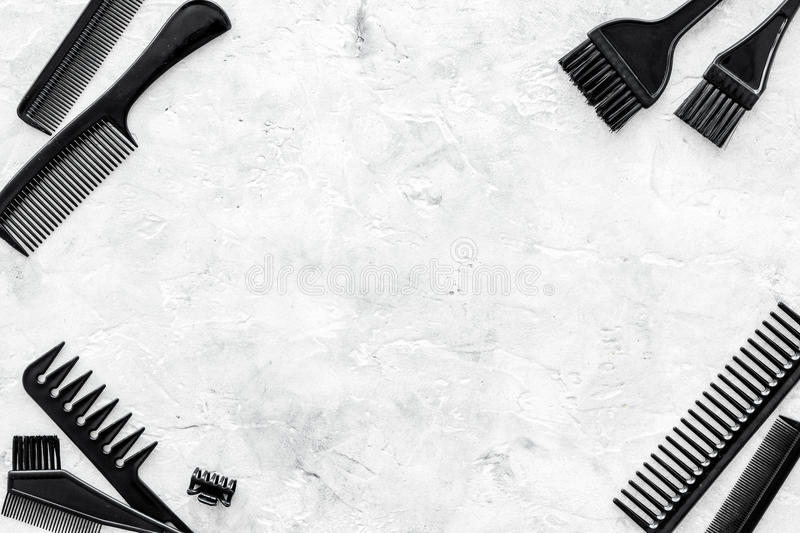 Combs and hairdresser tools on stone work desk background top view mockup stock photography