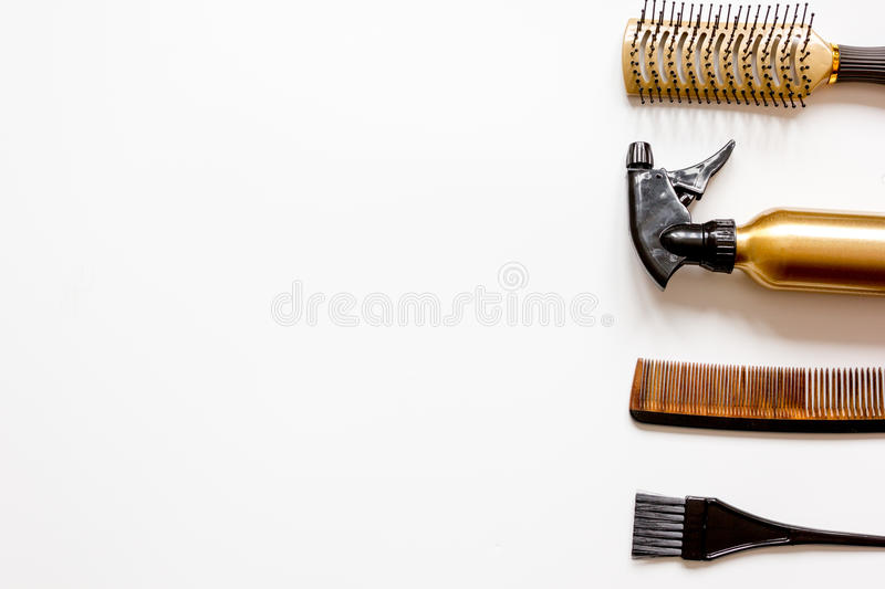Combs and hairdresser tools on white background top view.  royalty free stock photography