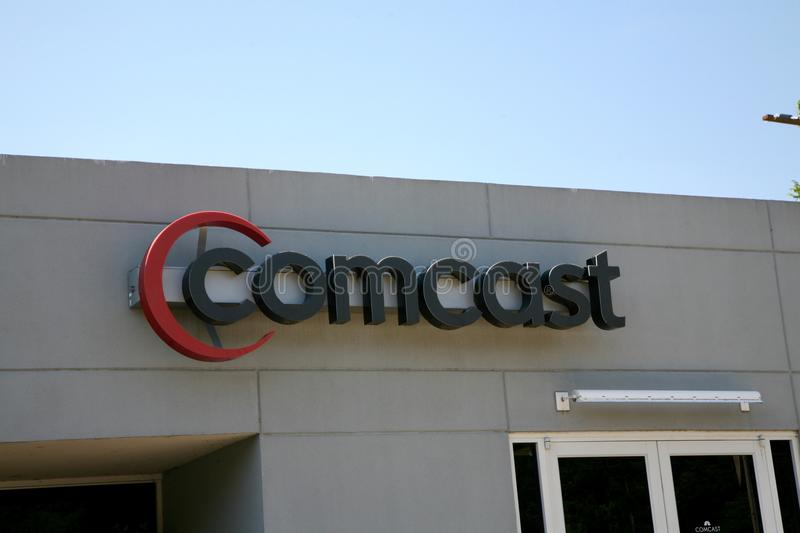 Comcast Cable. Communications is the cable television division of Comcast. The division primarily markets its consumer-oriented services under the brand Xfinity stock image