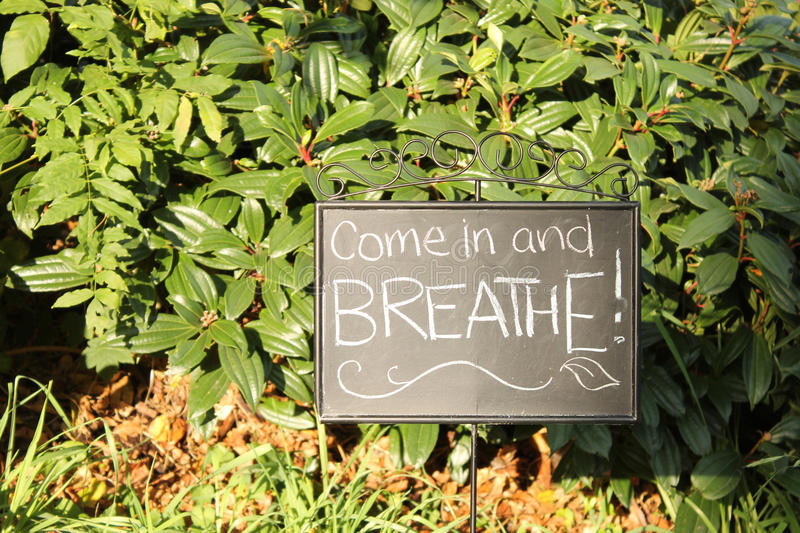 Come in and Breathe Sign. Chalkboard sign that reads Come in and Breathe stock photos