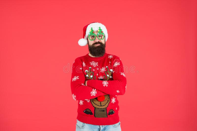 Come get ready for Christmas. bearded man santa hat red wall. christmas time. male xmas party glasses. happy new 2020 royalty free stock images