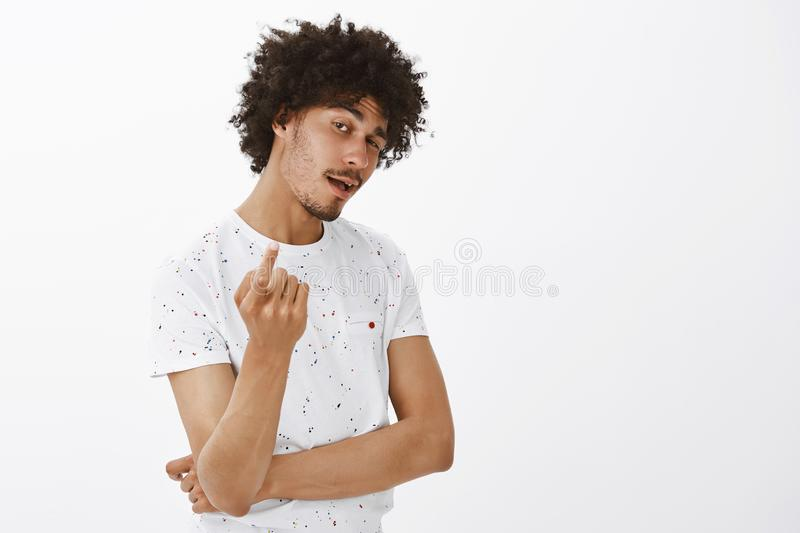 Come here, bring it. Portrait of confident good-looking stylish hispanic mature guy with moustache and curly hairstyle royalty free stock photography