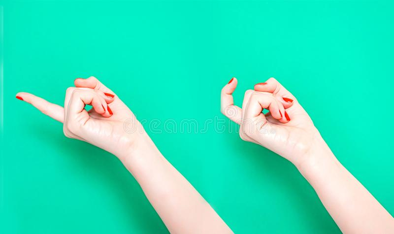 The Come Hither Hand Sign. Woman hand beckoning on isolated turquoise green color background. Female hand beckoning. Isolated on white background. Woman stock images