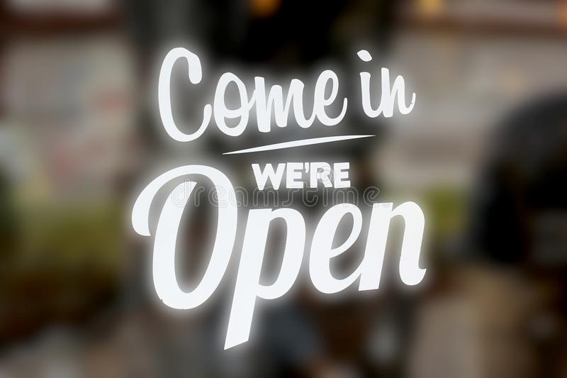 Come in we are open sign stock image