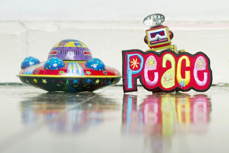 We come in pease retro robot and UFO  toys royalty free stock photography