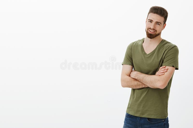 Come on, quit joking, let get to business. Portrait of handsome enthusiastic bearded guy in confident pose cross hands royalty free stock image
