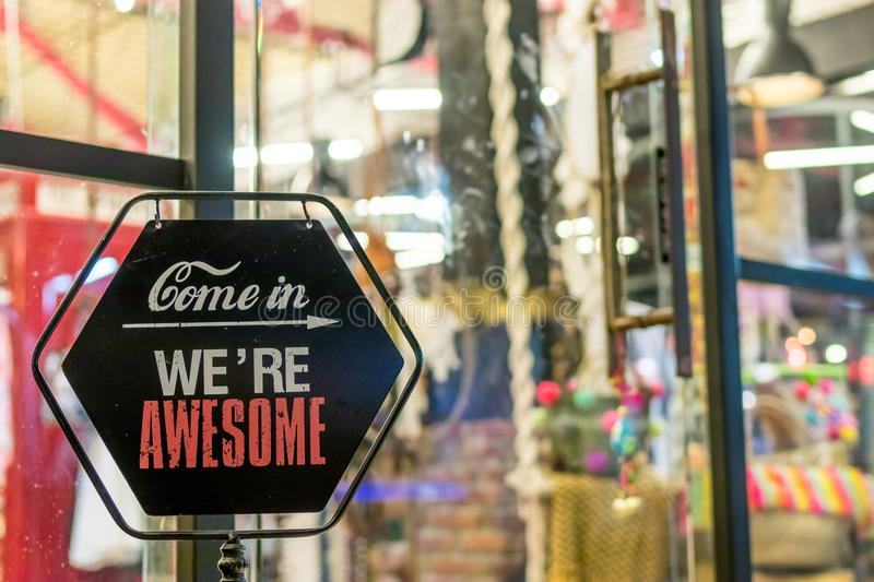 Come in We're Awesome Sign stock photos
