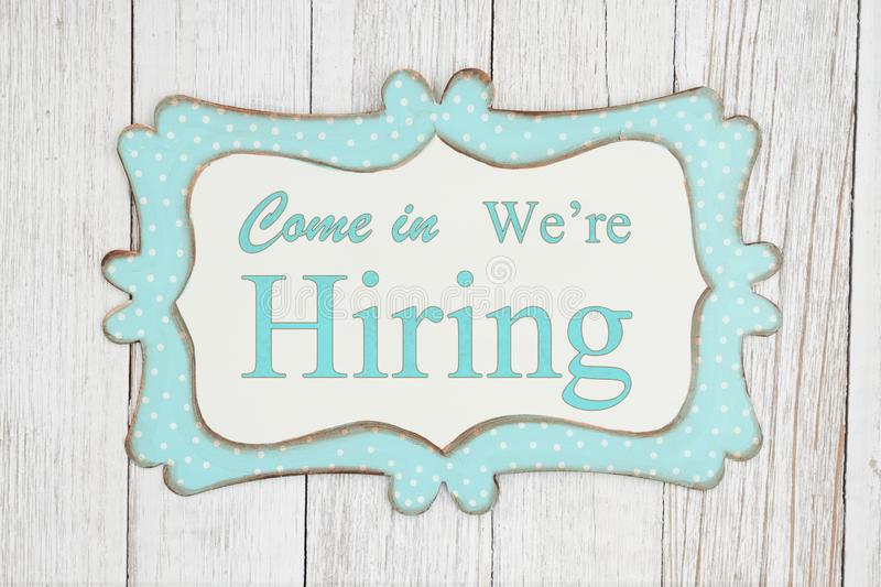 Come in we`re hiring text on a retro tin polka dot picture sign royalty free stock photography