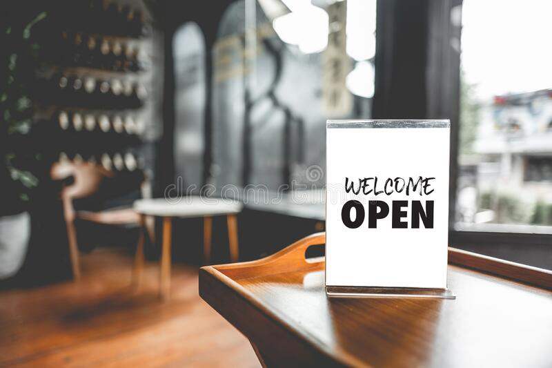 Come in we`re open  in cafe owner open startup with cafe shop stock images