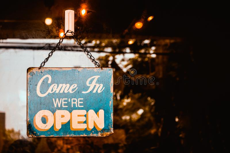 Come In We`re Open sign on door of cafe royalty free stock images
