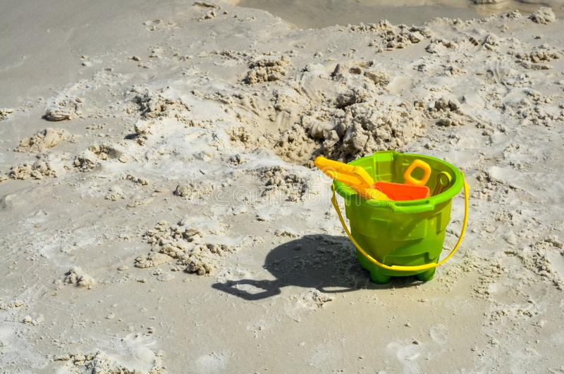 Come to beach bring your sand toys and play! stock photos