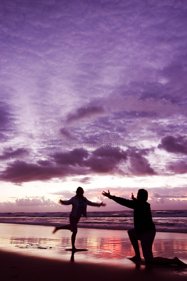Come to Daddy. Couple at the beach royalty free stock photos